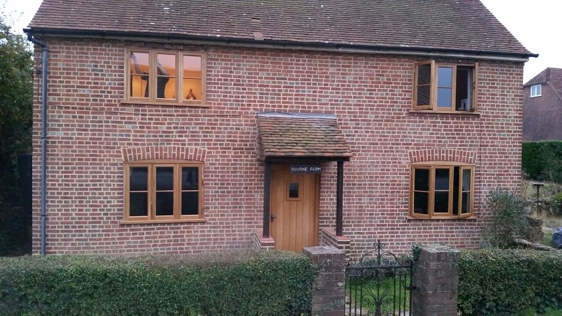 period building fitted with wooden casement windows